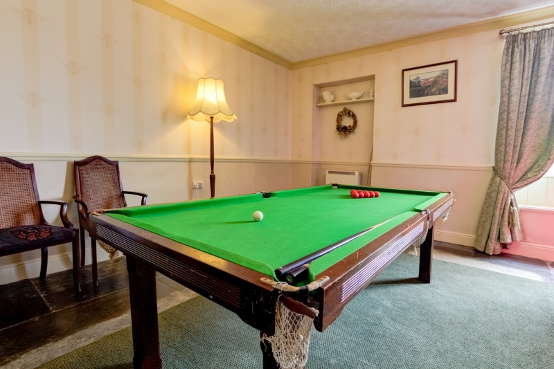 snooker table in dinning room